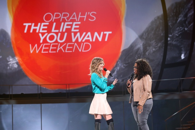 "Oprah Winfrey with Amy Purdy on stage during ""Oprah's The Life You Want Weekend"" at the Toyota Center"