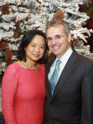 117 Dr. Lynda Chin and Dr. Ron DePinho at the M.D. Anderson Santa's Elves party December 2013